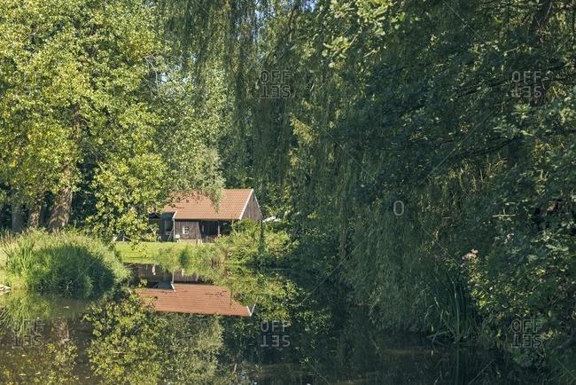 Car port near pond in rural garden in the Netherlands