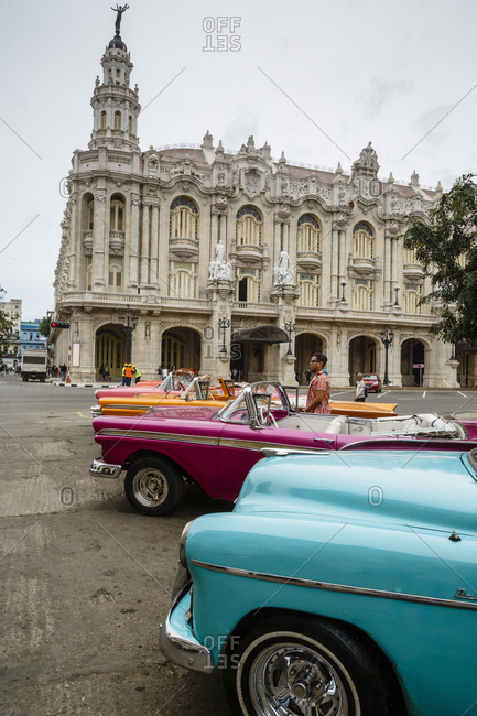 January 21, 2016: Vintage American cars parked outside the Gran Teatro (Grand Theater), Havana, Cuba, West Indies, Caribbean, Central America