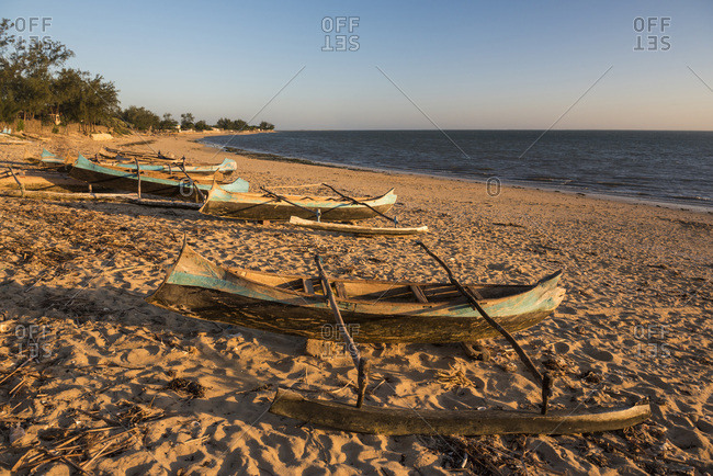 Dugout canoes used as fishing boats on Ifaty Beach at sunset, South West Madagascar, Africa