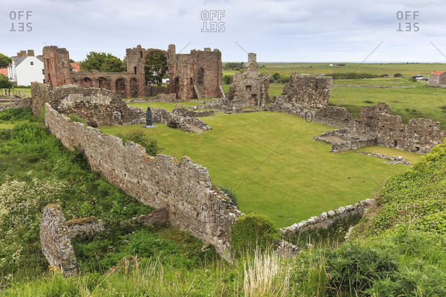 Lindisfarne Priory, early Christian site, and village, elevated view, Holy Island, Northumberland Coast, England, United Kingdom, Europe