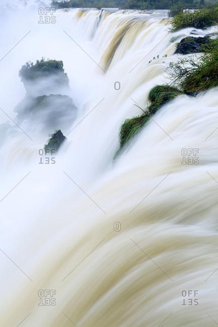 Iguacu (Iguazu) (Iguassu) falls in full flow, UNESCO World Heritage Site, Argentina, South America