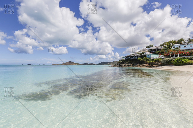 A beachfront resort surrounded by flowers and plants, Ffryes Beach, Antigua, Antigua and Barbuda, Leeward Islands, West Indies, Caribbean, Central America