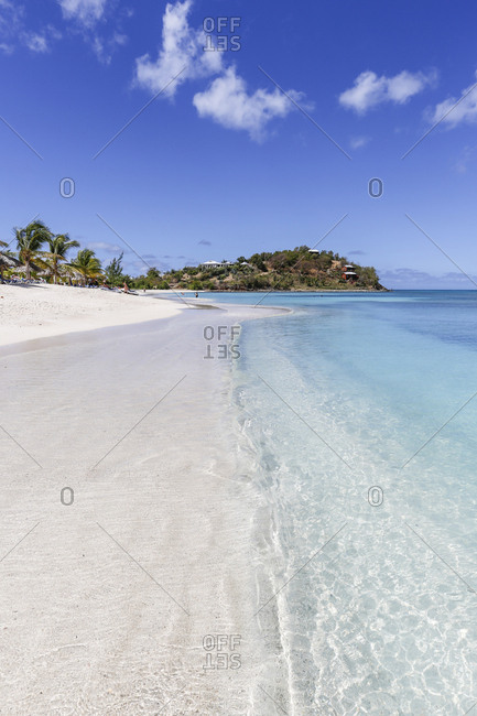 Palm trees and white sand surround the turquoise Caribbean sea, Ffryes Beach, Antigua, Antigua and Barbuda, Leeward Islands, West Indies, Caribbean, Central America