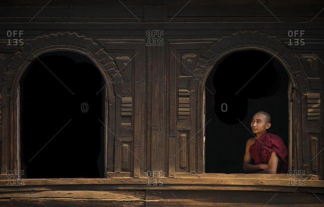 April 7, 2010: A monk looks out from the window of a wooden monastery near Bagan (Pagan), Myanmar (Burma), Asia
