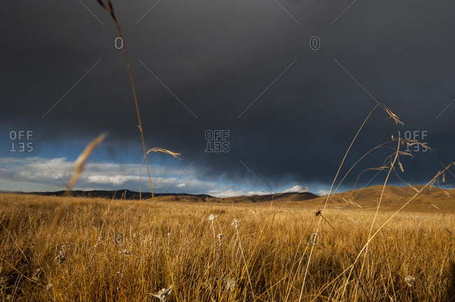 Stormy sky over rangelands on the edge of the Tibetan Plateau in Sichuan Province, China, Asia
