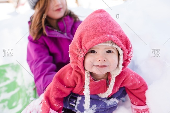 Two children outside together in the snow