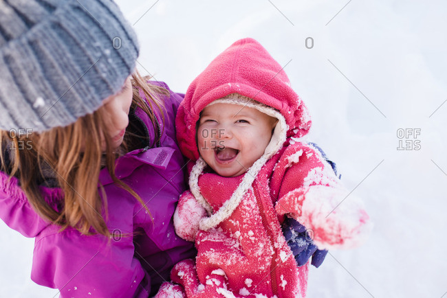 Children playing outside together in the snow