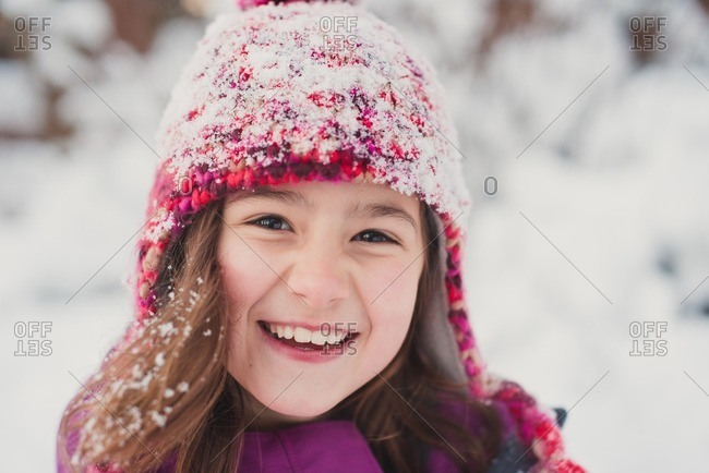Portrait of a smiling girl outside in the snow