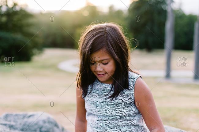Portrait of girl standing outside