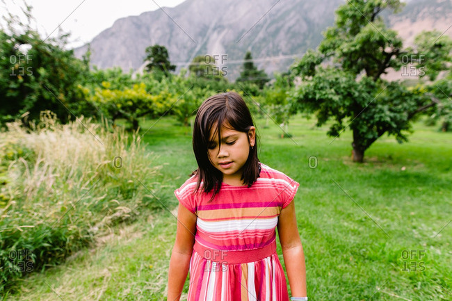 Girl walking through a fruit orchard