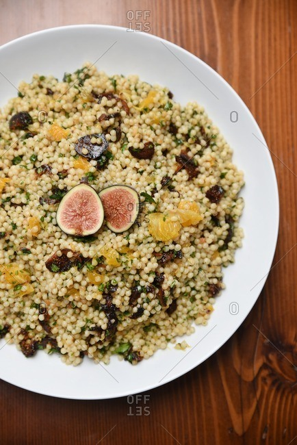 Serving plate of quinoa with figs and herbs