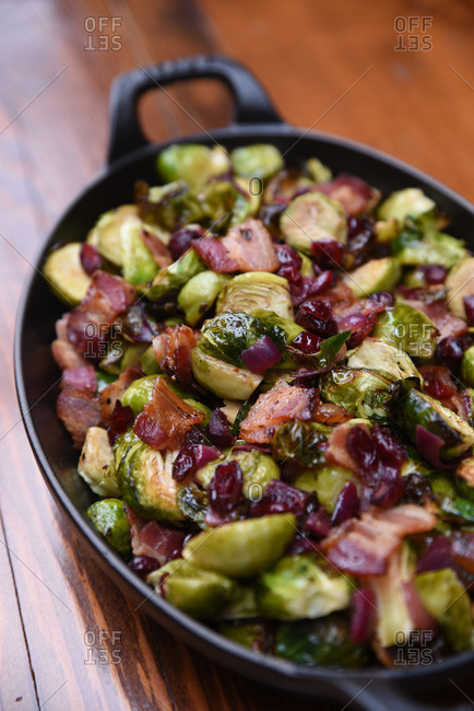 Brussels sprouts with bacon and cranberries in a skillet