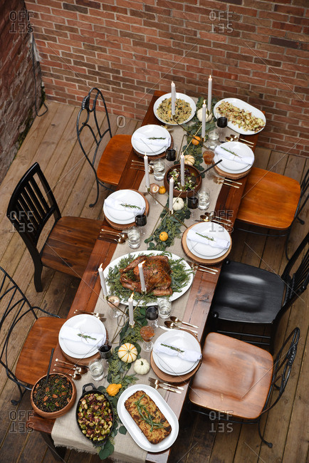 Rustic banquet table with mismatched spread with platters of food