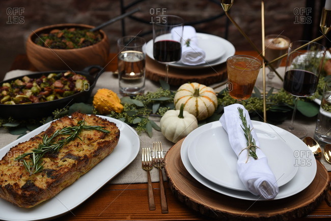 Serving platters of food on a table with rustic natural decorations