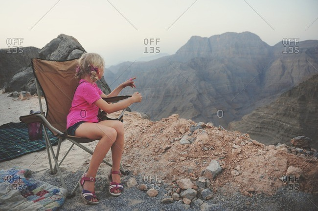 Girl sitting in the mountains, UAE