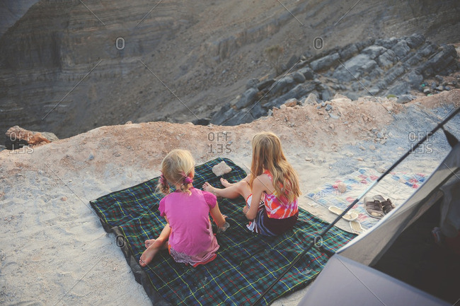 Girls camping in rugged mountains