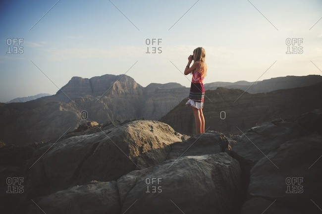 Girl looking over rugged mountains