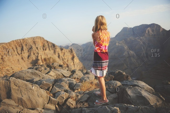 Girl on rugged mountain peaks