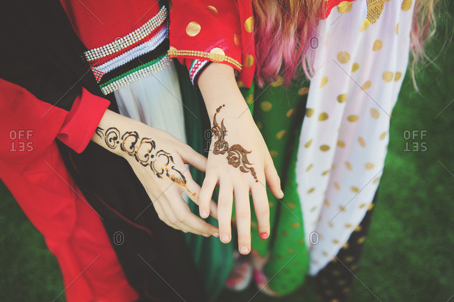 Girls with henna tattoos on hands