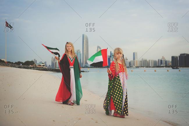 Girls waving UAE flags
