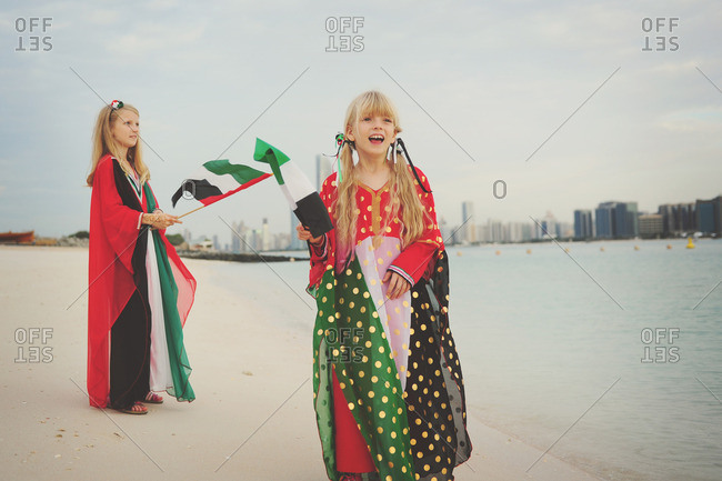 Girls with UAE flags on beach