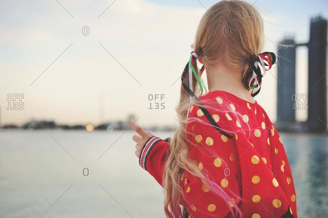 Girl on beach with UAE flag