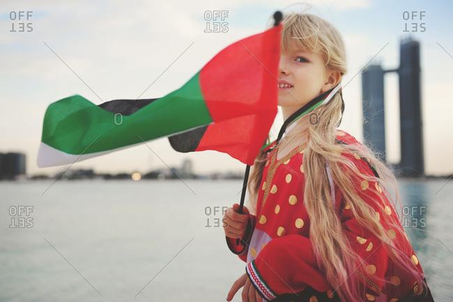 Girl holding a UAE flag