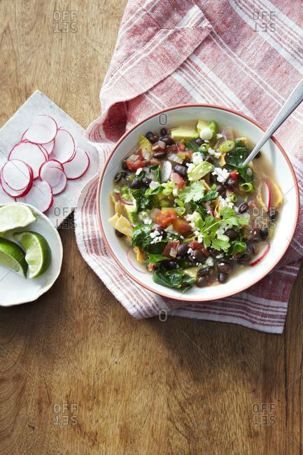 A tortilla soup with various veggies