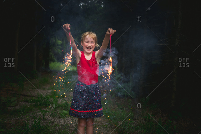Girl happily holding fireworks