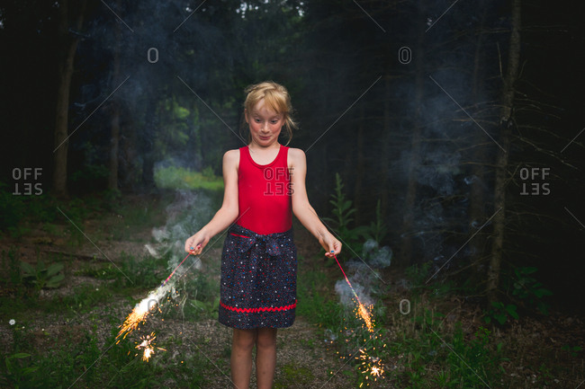 Girl nervously holding fireworks