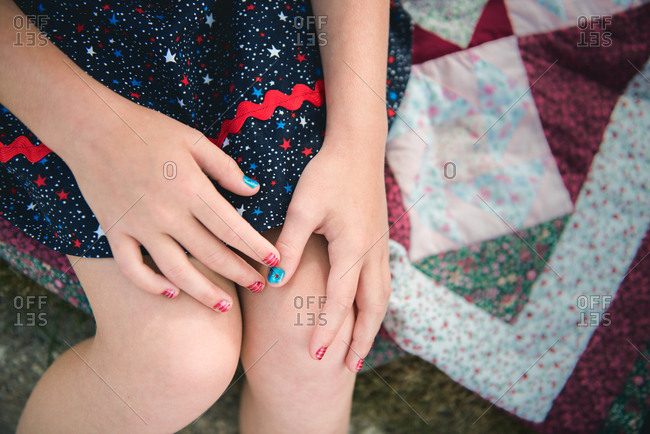 Girl with patriotic fingernails
