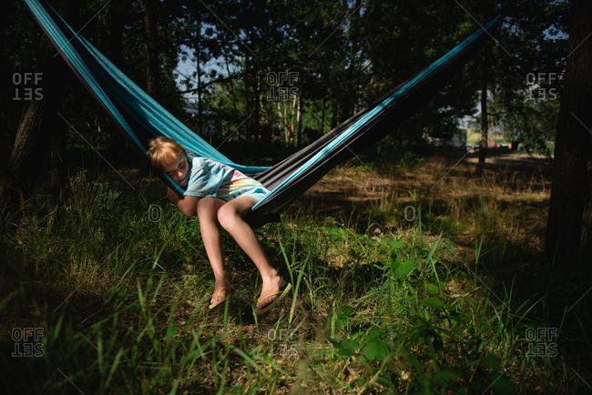 Sleepy girl resting in hammock
