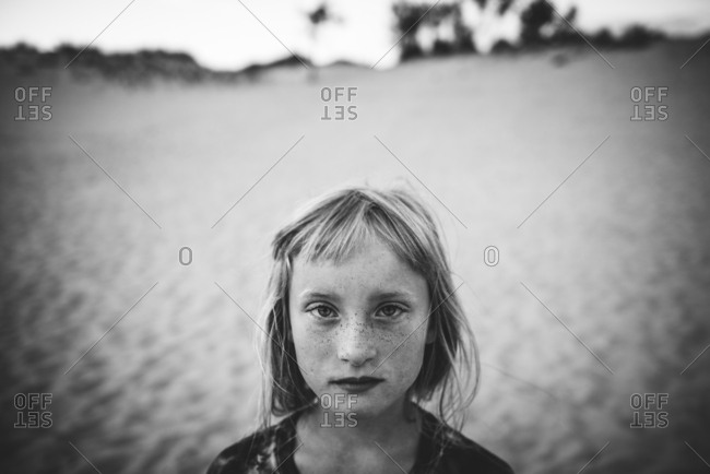 Portrait of freckled girl at beach