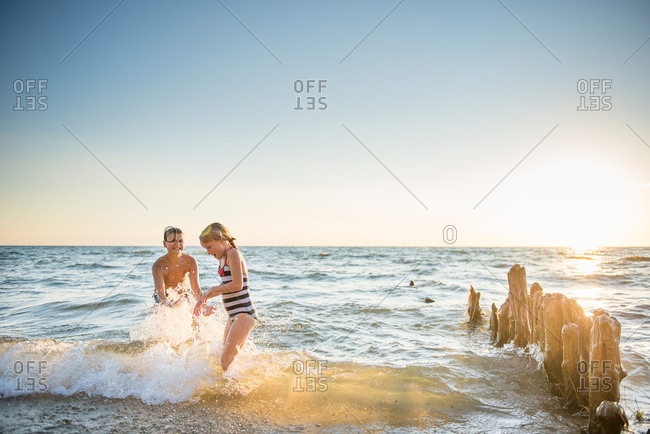 Kids splashing each other in lake