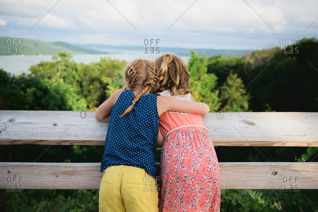 Girls looking out over rural vista