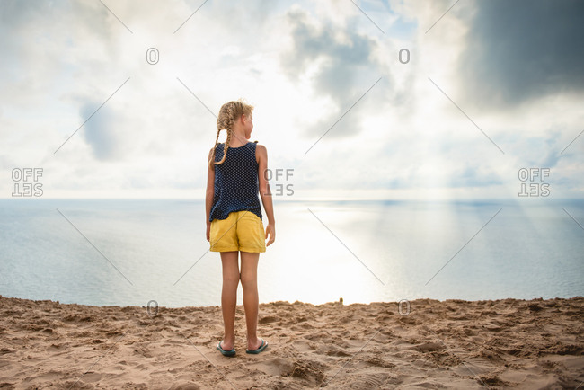 Girl on lake shore beach