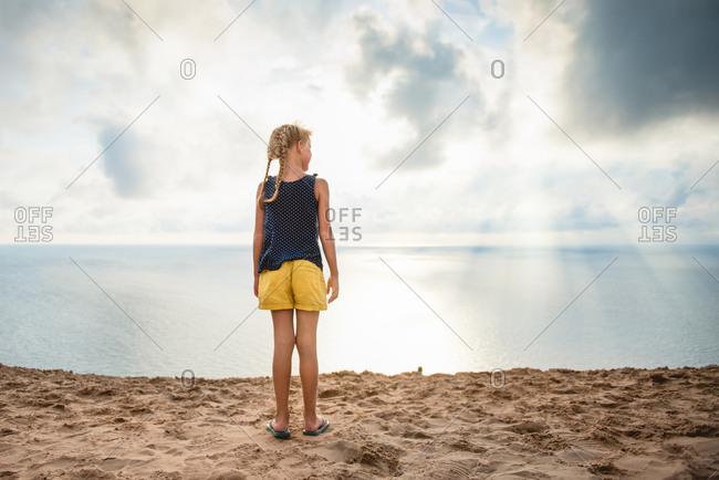 Girl on lake shore beach