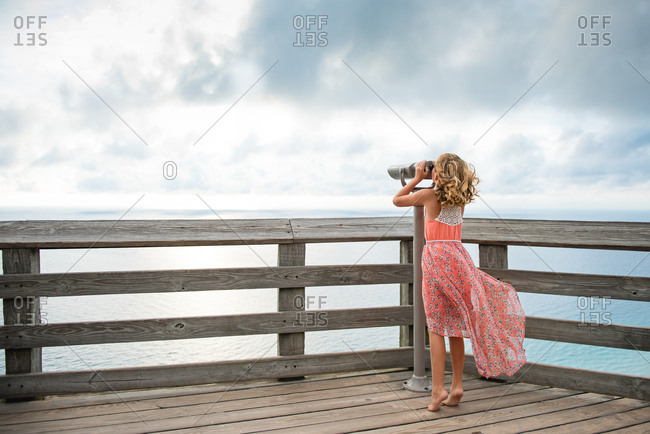 Girl on a lake overlook
