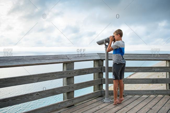 Boy at a lake overlook