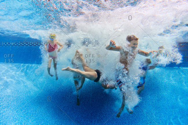 Kids in pool water after jump