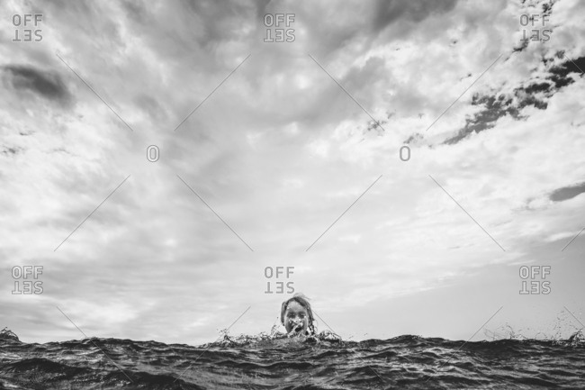 Girl laughing in wave's splash