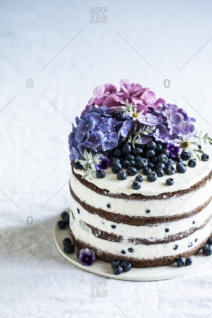 Cake with petals and blueberries