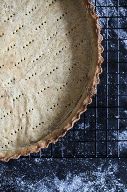 A baked pie crust cooling