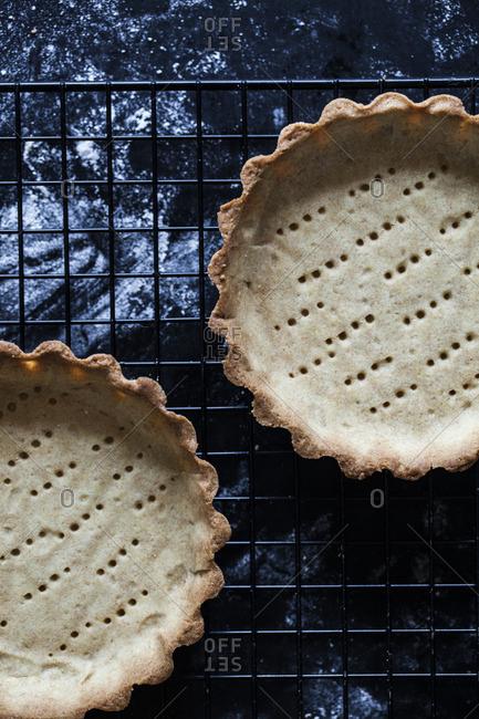 Baked pie crusts on rack