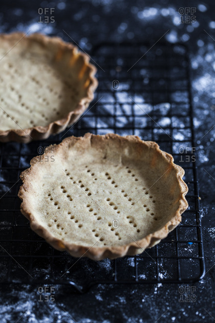 Baked pie crusts on a rack