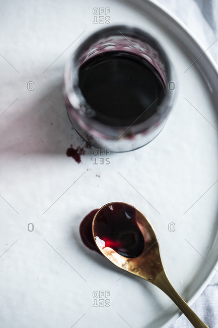Wine reduction on brass spoon