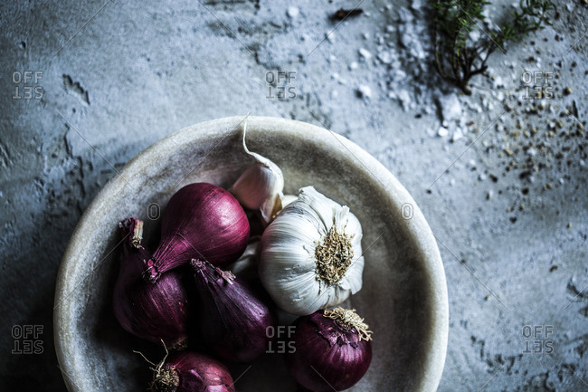 Garlic bulbs and red onions