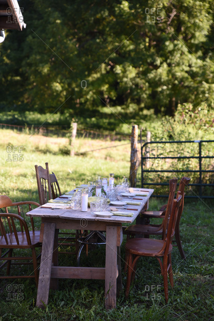 Table set for dinner in field