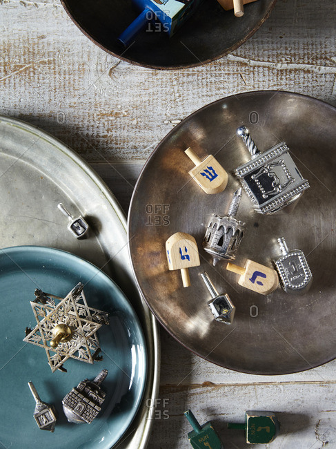 Dreidels in metal bowl