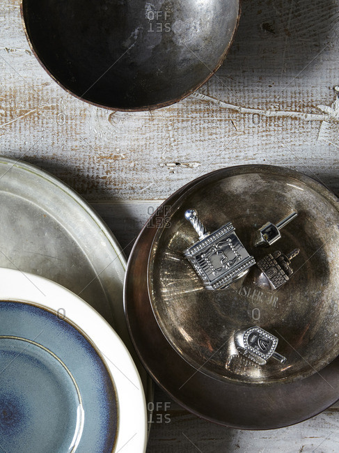 Dreidels in a metal bowl